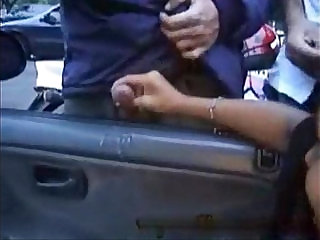 Brazilian girls give many strangers handjobs outside of car window