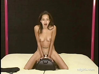 Asian girl Daisy rides the sybian to orgasm for the first time