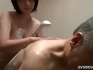 japanese school girl titjob and blowjob for older man in bathroom