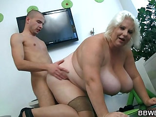Huge blonde lady gets doggystyled