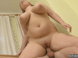Busty plumper enjoys riding and sucking his big rod