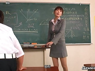 Teacher taking extra interest in couple of her students