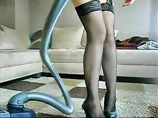 Sophie in miniskirt glasses and stockings plays with her hairy wet pussy
