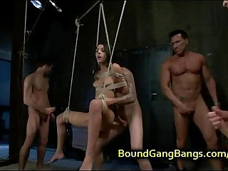 Bound suspended babe gets double penetrated