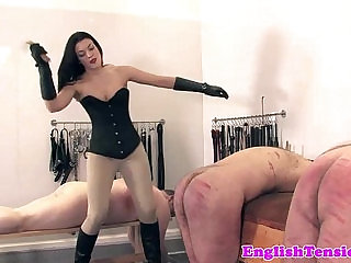 Leather domina belting and whipping subs
