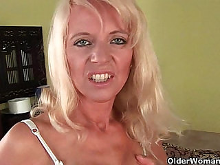 Sultry senior mom probes her old pussy fucked with a large dildo