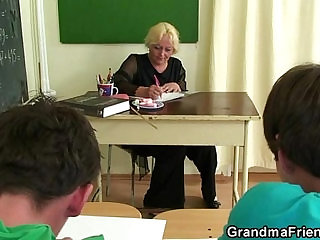 Mature teacher fucked by two horny guys
