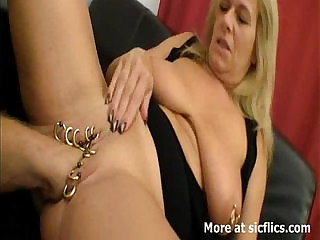 Heavily pierced cunt fisting