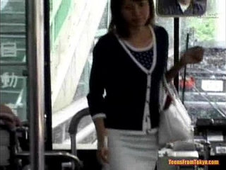 A young girl enters a public bus and sits down from sexvideo.wtf