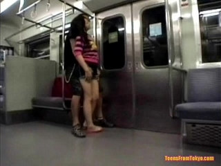 A young Asian girl is in a train. A man is standing from sexvideo.wtf